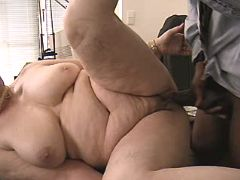 Hot granny fucks on table in office