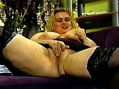 Obese vixen in black lingerie gets cumload on tits