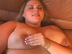 Blond fatty enjoys vibrator on sofa
