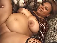Paunchy ebony fucked by boyfriend